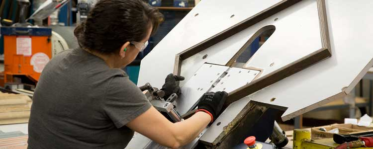 Hobby Lobby's manufacturing arm, Greco, makes custom frames for customers across the country.